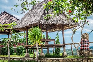 Wooden gazebo on a tropical island Bali, Indonesia.
