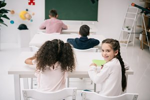 pupils sitting at desks