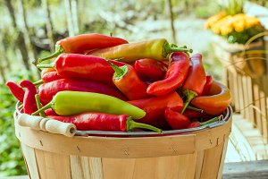 Wooden basket of hot peppers