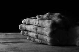 Hands folded for prayer