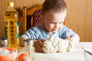 child on the kitchen kneads