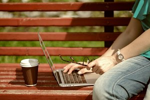 woman on the bench with laptop