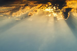 Horizontal vivid vibrant cloudscape with sun rays background bac