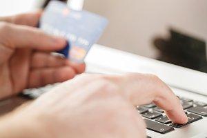 Man Shopping Online Using Laptop