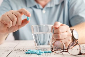 pills and a glass of water