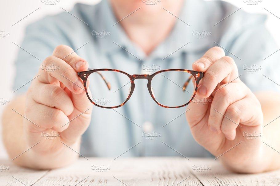 e6d8ec200c33 optometrist giving glasses ~ Photos ~ Creative Market
