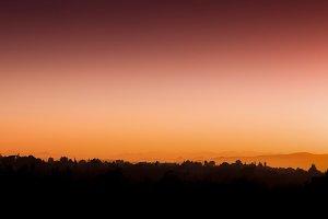 Horizontal red orange vivid Turkish sunset horizon silhouette ba