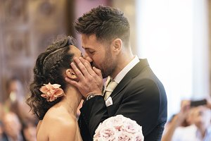 Couple of just married kissing.