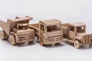 Three toy cars. Trucks and dumper.