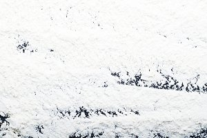 Abstract flour background on black background. Horizontal studio shot.
