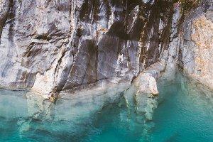 Turquoise Pond and Dark Rocks