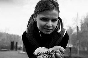 Square black and white girl holding small spheres bokeh backgrou