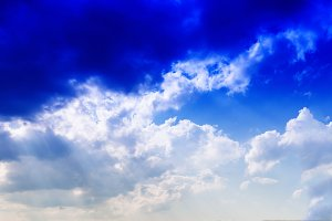 Horizontal vivid blue cloudscape dramatic clouds background back