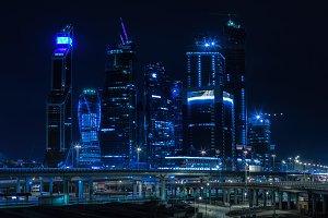 Horizontal vivid blue night Moscow city business center backgrou