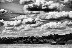 Horizontal vivid vibrant black and white Russia river clouds lan