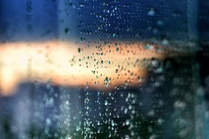 Raindrops on glass abstract background