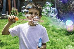 Child makes bubbles