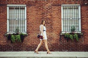 student woman walking at campus