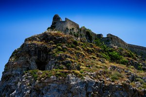 Horizontal vivid abandoned castle on the rock hill landscape bac