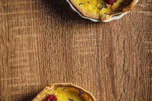 Lemon tart with rosemary and berries