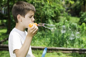 Child makes bubbles