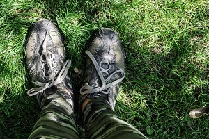 Foots on  green meadow