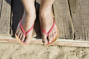 Women foots on the beach