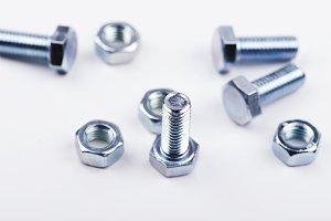 Nuts and bolts on white background. Isolated.