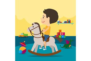 Boy riding toy horse in kindergarten