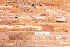 Textured red stone wall background