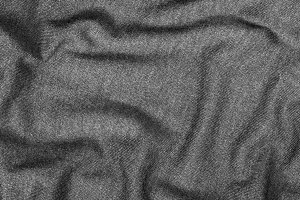 Fabric warm gray cotton sweater. Black and white photo.