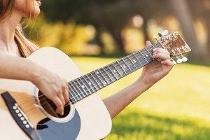 Beautiful woman playing guitar.