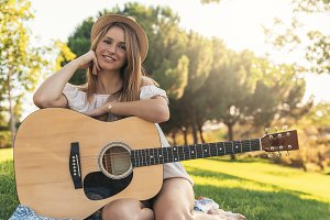 Beautiful woman playing guitar.