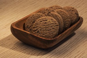 chocolate biscuits in wooden bowl