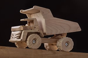 Dumper toy car made of wood.