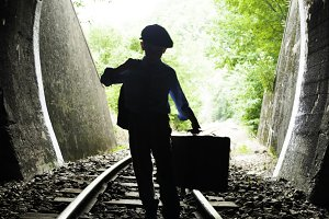 Child walking on railway road