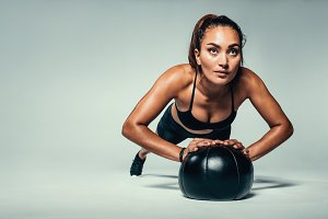 Fit woman doing push up