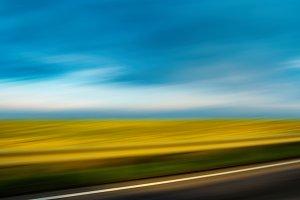 Diagonal highway vivid summer landscape motion abstraction