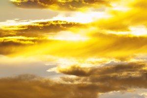 Horizontal vivid golden sunset clouds background backdrop