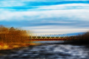 Moving train bridge motion abstraction