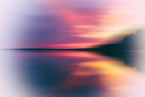 Evening sunset on smooth lake abstraction