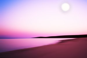 Horizontal dramatic sunset on lake with abstract moon background