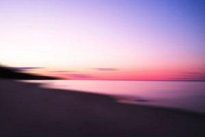 Horizontal dramatic sunset on lake abstract bokeh background