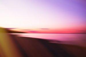 Horizontal dramatic sunset on lake abstract with light leak back