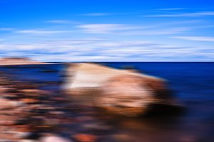 Vertical vivid stony beach motion blurred abstraction background