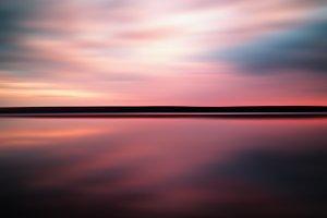Vivid sunset sunrise horizon lake reflections landscape abstract