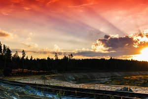 Horizontal red vivid sunset on vintage railroad track landscape