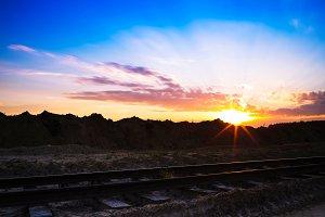 Horizontal vivid sunset on vintage railroad railway landscape ba