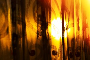 Horizontal vivid sunset curtains with light leak background