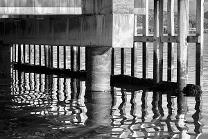 Black and white vibrant Norway quay reflection abstract backgrou